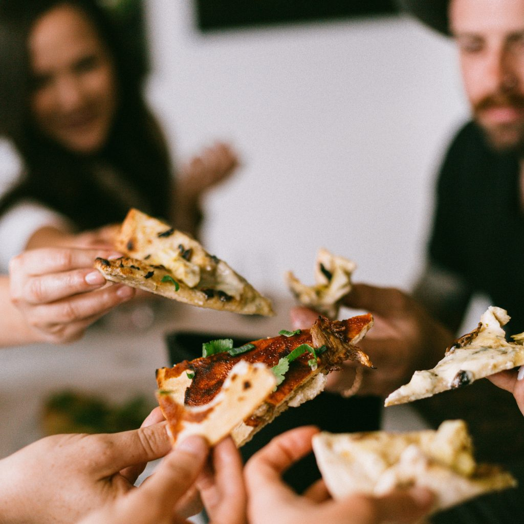 Uber Eat pizza delivery being shared with staff